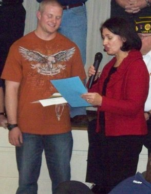 Joshua Meyers receiving Proclamation from the LZ Village President/Mayor Suzanne Braanding